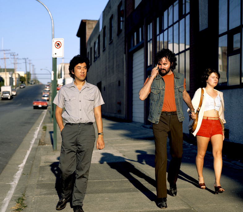 Jeff Wall's Mimic 1982 that recreates with actors a scene of of racial abuse Wall witnessed on a Vancouver Street.