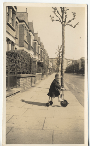 My father playing in the street in Cricklewood, North London between the wars.